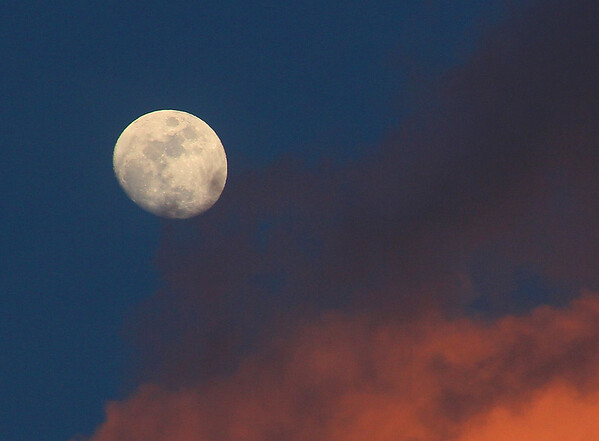 An almost full moon with colorful clouds from a nice sunset.<br /> <br /> Photographer's Name: Jerry Byard<br /> Photographer's City and State: Anderson, Ind.