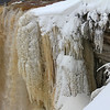 A buildup of ice beside the flowing Tahquamenon Falls in Upper Michigan.<br /> <br /> Photographer's Name: Jerry Byard<br /> Photographer's City and State: Anderson, Ind.