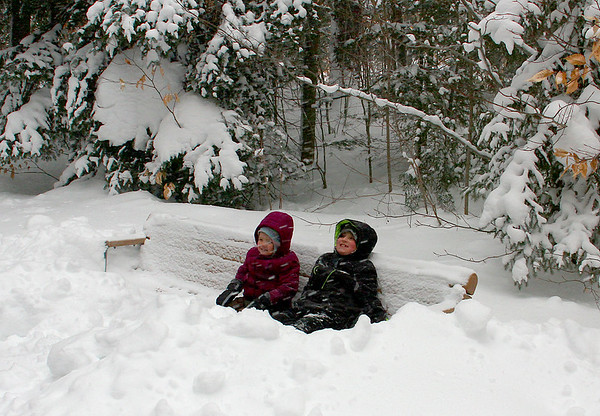 Two kids enjoying posing to show the depth of the snow at Tahquamenon Falls State Park.<br /> <br /> Photographer's Name: Jerry Byard<br /> Photographer's City and State: Anderson, Ind.