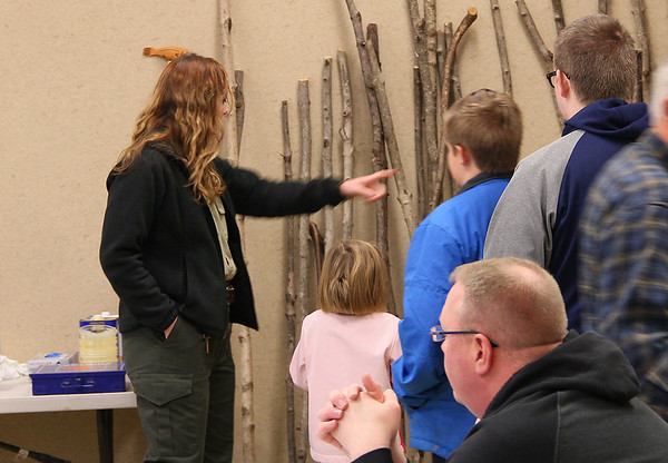 Riley is helping some guys pick out a stick for the walking stick workshop at Mounds Park.<br /> <br /> Photographer's Name: Jerry Byard<br /> Photographer's City and State: Anderson, Ind.