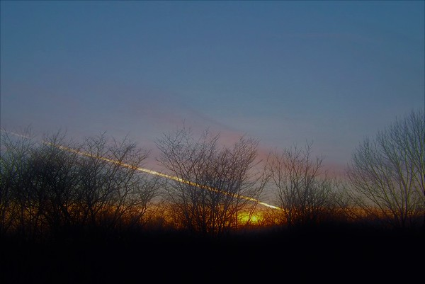 Jet contrails  at dusk in Richland Township.<br /> <br /> Photographer's Name: J.R. Rosencrans<br /> Photographer's City and State: Alexandria, Ind.
