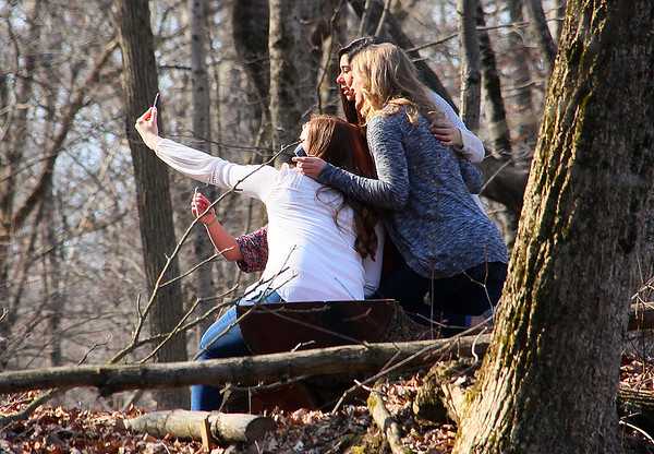 Girls at Mounds Park taking a selfie by the river.<br /> <br /> Photographer's Name: Jerry Byard<br /> Photographer's City and State: Anderson, Ind.