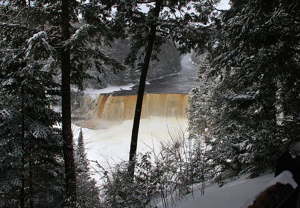 A view of Tahquamenon Falls through the snowy woods.<br /> <br /> Photographer's Name: Jerry Byard<br /> Photographer's City and State: Anderson, Ind.
