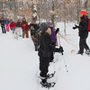 A group of snowshoe hikers at Tahquamenon Falls listening to the naturalist Theresa.<br /> <br /> Photographer's Name: Jerry Byard<br /> Photographer's City and State: Anderson, Ind.