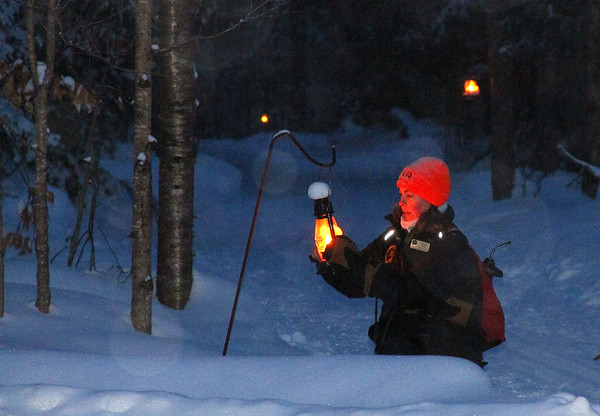 My friend a naturalist at Tahquamenon Falls State Park lighting the lanterns for the evening snowshoe hikers.<br /> <br /> Photographer's Name: Jerry Byard<br /> Photographer's City and State: Anderson, Ind.