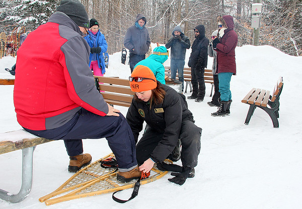 My naturalist friend fitting snowshoes for the popular hike at Tahquamenon Falls State Park.<br /> <br /> Photographer's Name: Jerry Byard<br /> Photographer's City and State: Anderson, Ind.