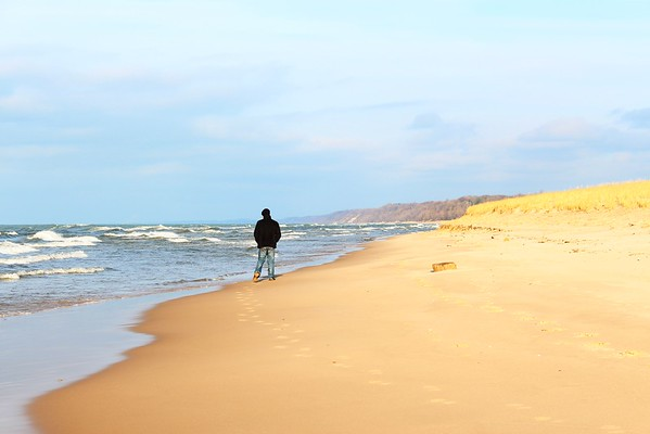 My son, Aaron Fox, walking down the beach of Lake Michigan in St. Joe Michigan.<br /> <br /> Photographer's Name: Brian  Fox<br /> Photographer's City and State: Anderson, Ind.