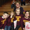 This is Elayna Cuneo and her grandchildren cheering on the Alexandria Tigers at a recent high school boys basketball game.<br /> <br /> Photographer's Name: Carrie Long<br /> Photographer's City and State: Alexandria, Ind.