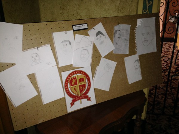"""Liberty Christian drawing students reacted to MLK in their sketchbooks as they drew his face and fist, capturing that we are """"Free at Last.""""<br /> <br /> Photographer's Name: Beth Webb<br /> Photographer's City and State: Anderson, Ind."""