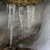Dripping icicles in a tiny cave at Mounds Parks on a thawing day.<br /> <br /> Photographer's Name: Jerry Byard<br /> Photographer's City and State: Anderson, Ind.