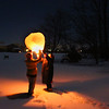 Two friends launching a Chinese Lantern to ring in the new year on Sunday night.<br /> <br /> Photographer's Name: Jerry Byard<br /> Photographer's City and State: Anderson, Ind.