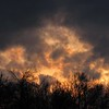 A fiery sky seen in a mid-January sunset.<br /> <br /> Photographer's Name: Harryv Van Noy<br /> Photographer's City and State: Lafayette Township, Ind.