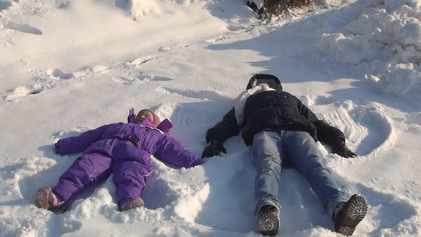 My niece Alisa, 4, and I making a snow angel to end 2017.<br /> <br /> Photographer's Name: Nicole Winkler<br /> Photographer's City and State: Anderson, Ind.