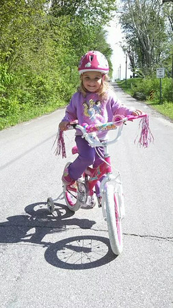 My daughter, Branlin, enjoying her new bike.<br /> <br /> Photographer's Name: Molly McCoy<br /> Photographer's City and State: Anderson, Ind.
