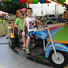 This is Kendall Long, 5, with her cousin, Carter Sovern, 5, riding the motorcycles at the Madison County 4-H Fair this week.<br /> <br /> Photographer's Name: Carrie Long<br /> Photographer's City and State: Alexandria, Ind.