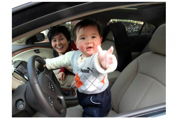 """Give me the keys Dad, mom's ready to go,"" says my grandson Eric, who is living in China.<br /> <br /> Photographer's Name: Harry Kirchenbauer<br /> Photographer's City and State: Anderson, Ind."