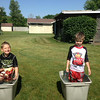 Acen and Haven Hostetler in their makeshift pools at their grandparents' house.<br /> <br /> Photographer's Name: Mark Hostetler<br /> Photographer's City and State: Anderson, Ind.