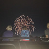 This is Ryan Long, Natalie Long, and Carson Cuneo watching the Summitville fireworks on the Fourth of July.<br /> <br /> Photographer's Name: Malinda Cuneo<br /> Photographer's City and State: Alexandria, Ind.