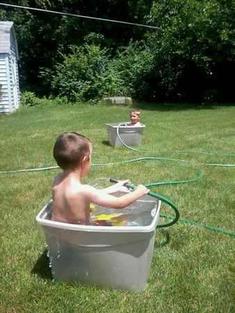 Acen and Haven Hostetler beating the heat at their grandparents' house.<br /> <br /> Photographer's Name: Mark Hostetler<br /> Photographer's City and State: Anderson, Ind.