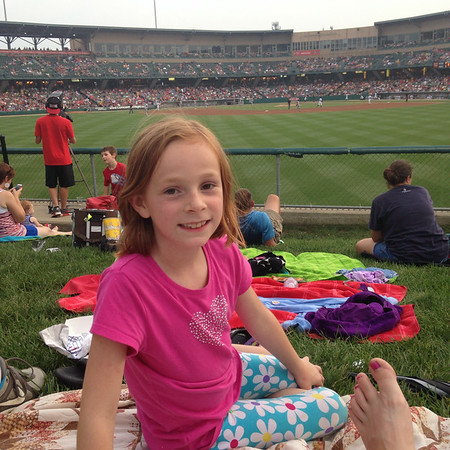 This is Natalie Long, age 8, of Alexandria, enjoying an Indianapolis Indians game at Victory Field.<br /> <br /> Photographer's Name: Carrie Long<br /> Photographer's City and State: Alexandria, Ind.