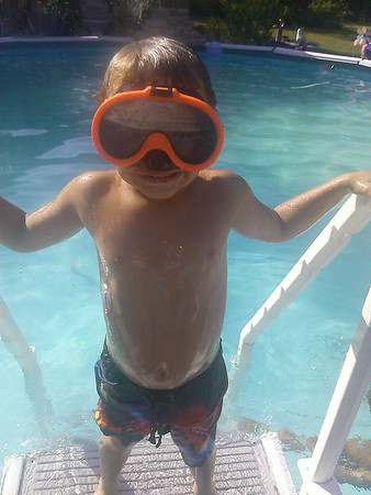 My son, Thias, enjoying the water for a cool down!<br /> <br /> Photographer's Name: Molly McCoy<br /> Photographer's City and State: Anderson, Ind.