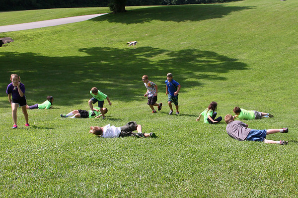 At Mounds Park after a day camp activity the kids decided to roll down the hill.<br /> <br /> Photographer's Name: Jerry Byard<br /> Photographer's City and State: Anderson, Ind.