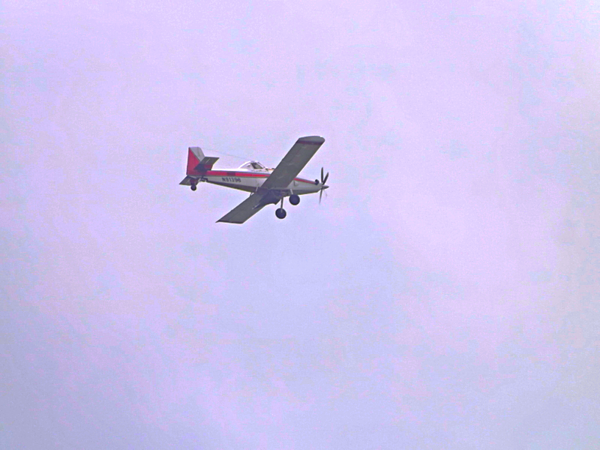 Cropduster flying over Richland Township.<br /> <br /> Photographer's Name: J.R. Rosencrans<br /> Photographer's City and State: Alexandria, Ind.