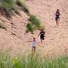 A group of kids were running down the Devil's Slide at the Indiana Dunes State Park.<br /> <br /> Photographer's Name: Jerry Byard<br /> Photographer's City and State: Anderson, Ind.