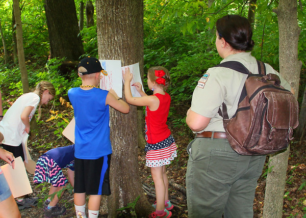 Naturalist Leah led a 'Stars and Stripes' hike on the Fourth of July as the kids looked for things representing the title of the hike.<br /> <br /> Photographer's Name: Jerry Byard<br /> Photographer's City and State: Anderson, Ind.