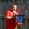 Dylan McDaniel shows off the bird house he built.<br /> <br /> Photographer's Name: Brian Fox<br /> Photographer's City and State: Anderson, Ind.
