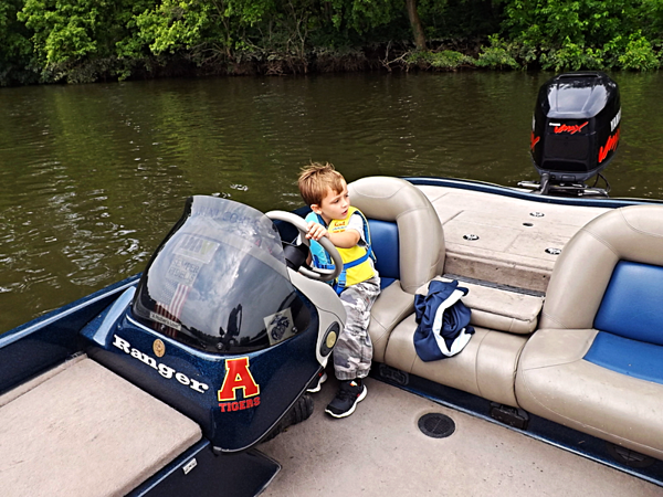 Impressing the girls by pretending to drive. My grandson Eli Coxe at Shadyside Lake.<br /> <br /> Photographer's Name: J.R. Rosencrans<br /> Photographer's City and State: Alexandria, Ind.