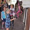 Children learning about horse care at Moon Rise  Farms in Richland Township.<br /> <br /> Photographer's Name: J.R. Rosencrans<br /> Photographer's City and State: Alexandria, Ind.