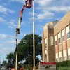 Mick Campbell paints the flagpole at Liberty Christian School, 2323 Columbus Ave.<br /> <br /> Photographer's Name: Elaine Heath<br /> Photographer's City and State: Anderson, Ind.