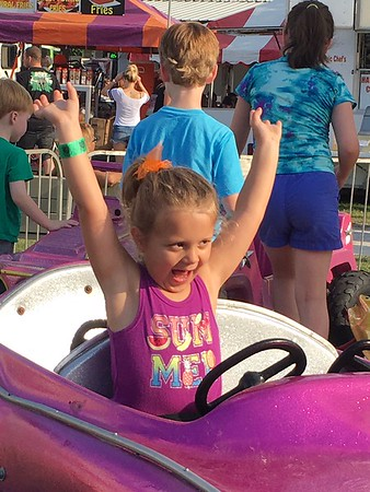My granddaughter, Ashlynn Siler, enjoying the rides at the Madison County 4-H Fair.<br /> <br /> Photographer's Name: Tammy McCord<br /> Photographer's City and State: Anderson, Ind.