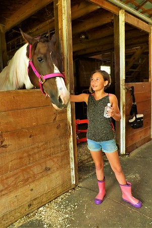 Lilly Bewster showing color coordination with boots and horse halter. Horse camp at Moon Rise Farms in Richland Township.<br /> <br /> Photographer's Name: J.R. Rosencrans<br /> Photographer's City and State: Alexandria, Ind.