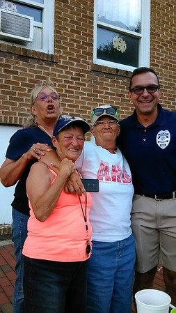 Parkview Place residents and Police Chief Watters celebrate hard work's payoffs and enjoy a concert in Dickmann Town Center. <br /> <br /> Photographer's Name: Rachel Arney<br /> Photographer's City and State: Anderson, Ind.