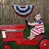 Charlotte Adams is riding the tractor that her Daddy rode when he was a little boy!<br /> <br /> Photographer's Name: Diana Adams<br /> Photographer's City and State: Frankton, Ind.