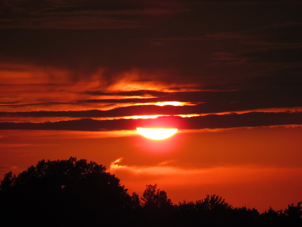 A mid-July sunset.<br /> <br /> Photographer's Name: Harry Van Noy<br /> Photographer's City and State: Lafayette Township, Ind.