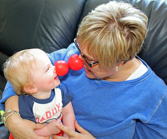 Emby Duncan and Angie Fox make sure their red noses fit.<br /> <br /> Photographer's Name: Brian Fox<br /> Photographer's City and State: Anderson, Ind.