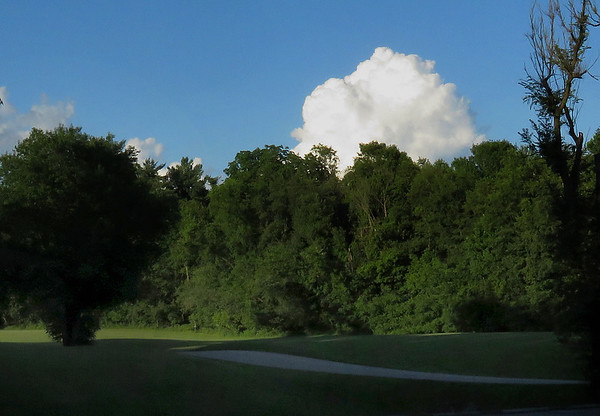 Mounds Park at sunset with a pretty cloud above the woods.<br /> <br /> Photographer's Name: Jerry Byard<br /> Photographer's City and State: Anderson, Ind.