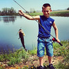 Owen Thompson and the bass he caught! It was about 15 inches long and weighed 4 pounds!<br /> <br /> Photographer's Name: Amber Myers<br /> Photographer's City and State: Alexandria, Ind.