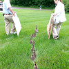 Photo by Sheryl Myers<br /> Tom Butler and Felicia Eisenhower, Bethany Pointe employees, escorting a mother mallard and her eleven 2 1/2 week old ducklings toward Killbuck Creek.  There were two mallards in the courtyard, each with 11 ducklings.  The residents gave the ducklings a warm sendoff and wished them good luck.