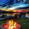 Lake cottage fire and sunset.<br /> <br /> Photographer's Name: Linda  Riedel Shively<br /> Photographer's City and State: Daleville, Ind.