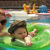 My grandson, Alex Z. Brown, enjoying his first swimming adventure at Grama's. :)  He fit perfectly in the cooler float!<br /> <br /> Photographer's Name: Colleen Brown<br /> Photographer's City and State: Anderson, Ind.