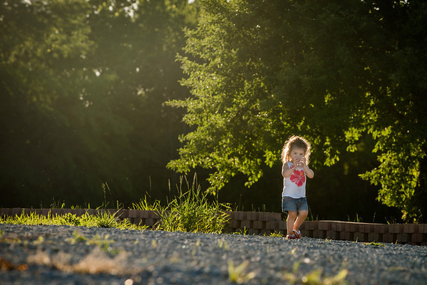 My granddaughter Aislynn Ayers walking with water in the sunset.<br /> <br /> Photographer's Name: Terry Lynn Ayers<br /> Photographer's City and State: Anderson, Ind.