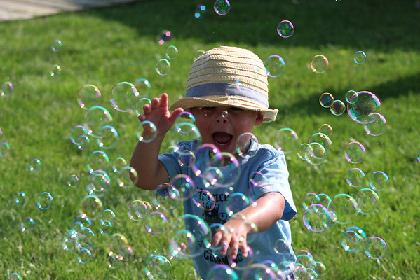 Ben Price tries to pop as many bubbles as he can on a recent summer day.<br /> <br /> Photographer's Name: Brian Fox<br /> Photographer's City and State: Anderson, Ind.