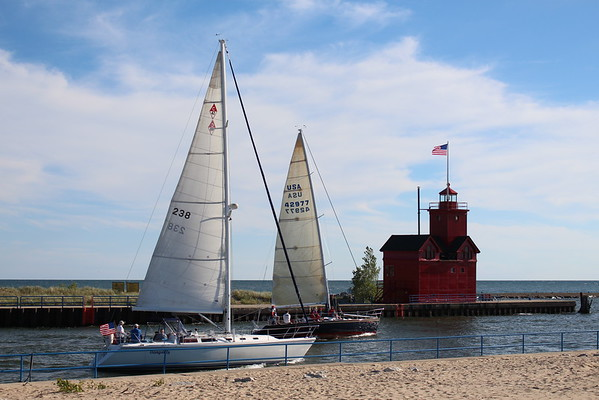 Sailboats race past Holland Harbor LIghthouse in Holland, Mich.<br /> <br /> Photographer's Name: Brian Fox<br /> Photographer's City and State: Anderson, Ind.