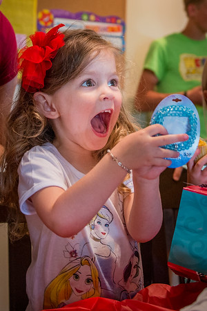 My granddaugher Aislynn Ayers is delighted with a birthday gift.<br /> <br /> Photographer's Name: Terry Lynn Ayers<br /> Photographers City and Country: Anderson, Ind.