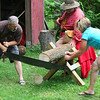 Heritage Days at Mounds Park on Saturday gave people a chance to experience sawing logs the old way.<br /> <br /> Photographer's Name: Jerry Byard<br /> Photographer's City and State: Anderson, Ind.