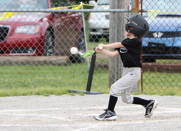 Landon Metz pounds the ball during his recent baseball game.<br /> <br /> Photographer's Name: Brian Fox<br /> Photographer's City and State: Anderson, Ind.